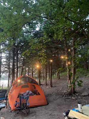 Camp Site in the Evening with Lights