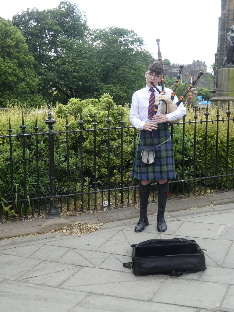 Scots piper outside Edinburgh Waverley Station