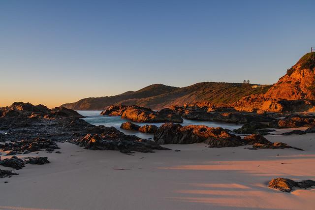 Sunrise seascape and a rocky beach