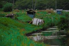 Suburban irrigation canal in the rain