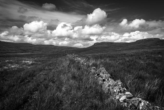Clouds and wall, Mistylaw Muir, Clyde Muirshiel Regional Park, Renfrewshire, Scotland, UK B&W