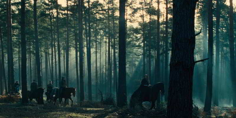 Gal Gadot on a horse in the forest
