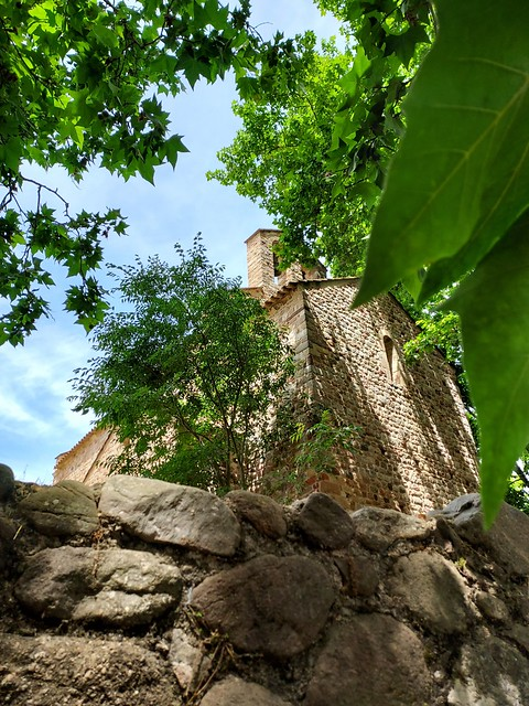 Wonderful view of Catalan romanesque style of the church and nature. Meravellosa vista, fusió natura arquitectura romànica. Santa Maria de Gallecs. Catalunya , Catalonia.