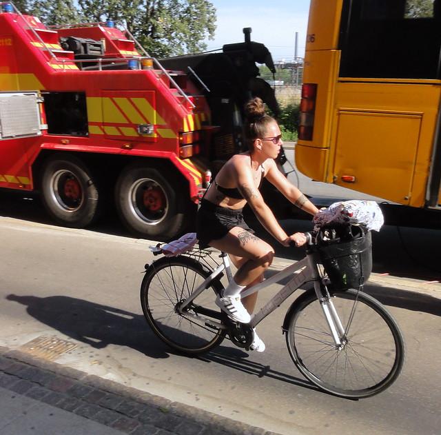 Copenhagen girl on a bike on hottest day of 2021 so far 31 degrees