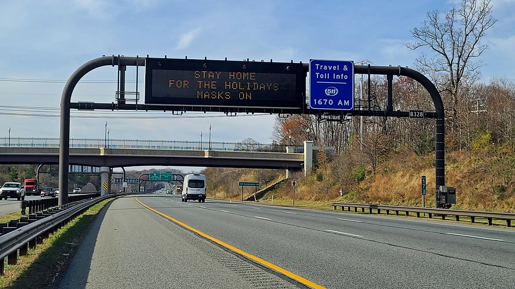 Variable message sign discouraging travel and encouraging mask wearing [01]
