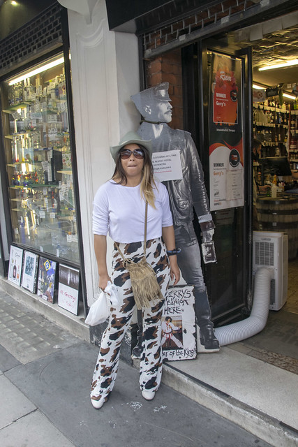 DSC_0783 Alesha Jamaican Model Out on the Town Cow Skin Print Trousers Pants White Top and Green Hat Fashion On Location Gerry's Wines & Spirits 74 Old Compton Street Soho London West End