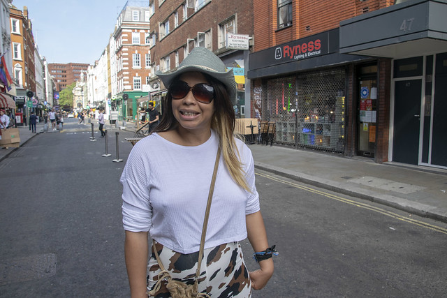 DSC_0781 Alesha Jamaican Model Out on the Town Cow Skin Print Trousers Pants White Top and Green Hat Fashion On Location Old Compton Street Soho London West End