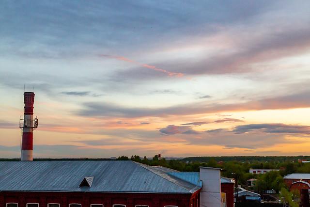 Savvino sunset and old factory chimney
