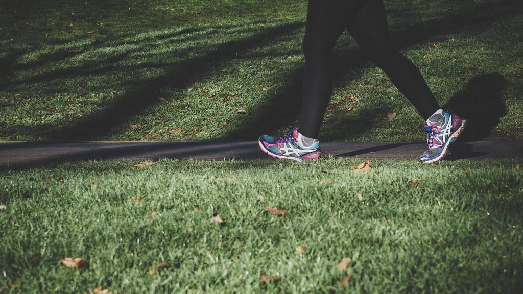 Walker striding across grass