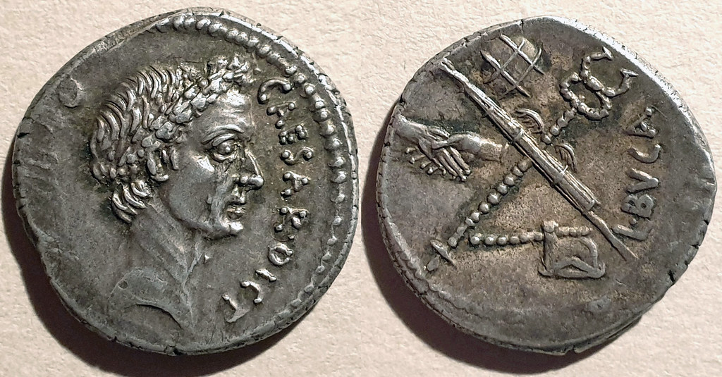 480/6 Denarius L. Aemilius Buca, Wreathed head of Caesar r., Fasces (without axe) and caduceus in saltire; on l. axe; on r., globe; above clapsed hands, Phillip Davis coll.