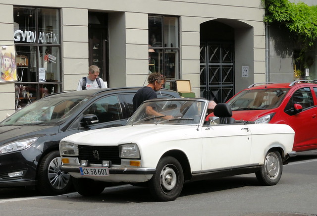 Rusty Peugeot 304 convertible CK58601 is still on the roads of Denmark