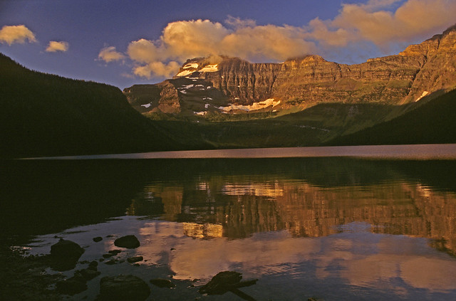 Early morning light on Mt. Custer, 8889'/2709m. rising more than 3400' above and reflected in Cameron Lake, Waterton Lakes National Park, Alberta, Canada.