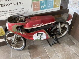 Old Kawasaki motorcycle in front of Rock Restaurant