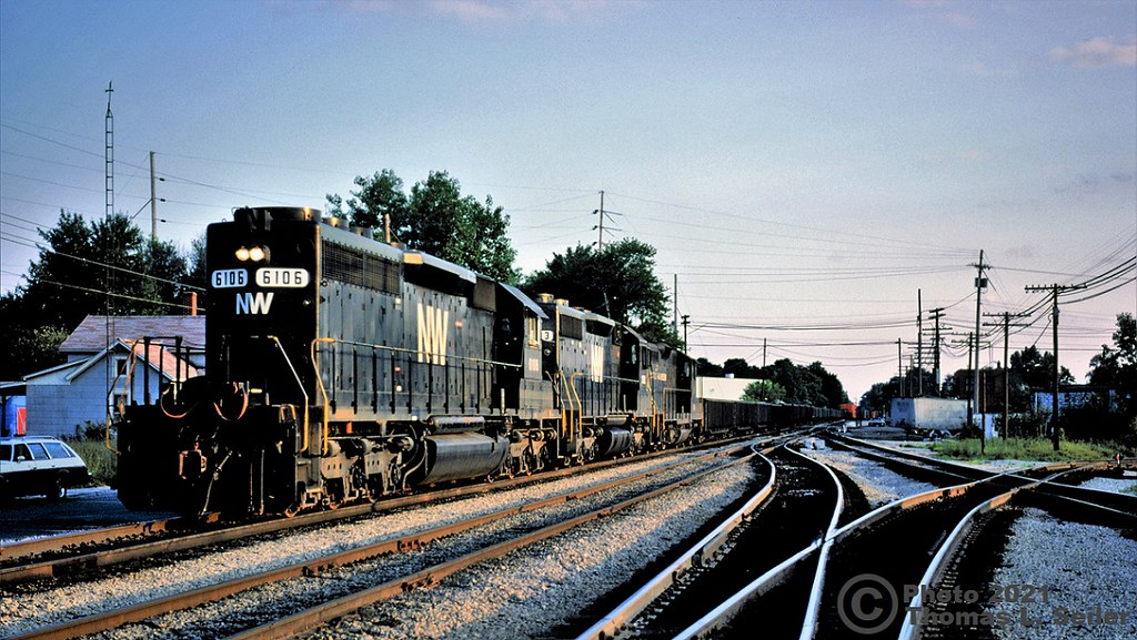 NORFOLK & WESTERN 6106 LEADS AN EASTBOUND INTO TOWN PAST THE OLD TOWER - BELLEVUE, OHIO - JUNE 19, 1982