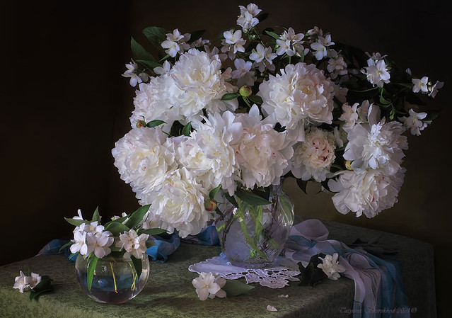 With a bouquet of peonies and jasmine