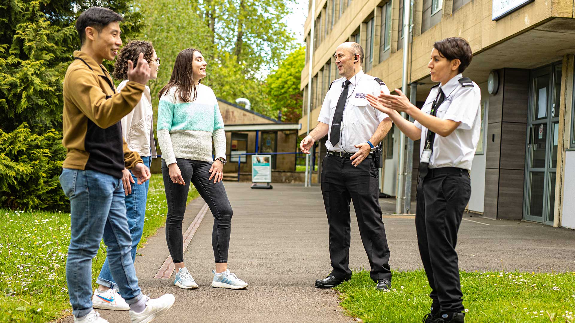 Security offers chatting to students outside accommodation.