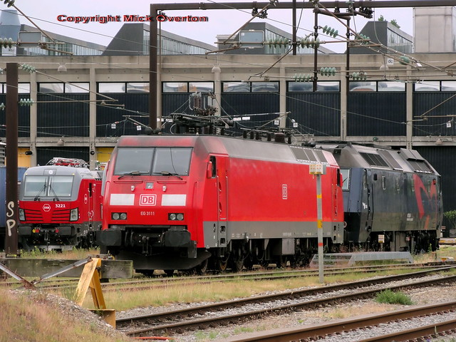 Electric loco DB EG3111 sits outside the DSB Copenhagen Central loco workshop looking like it has been pushed in by DSB ME1524
