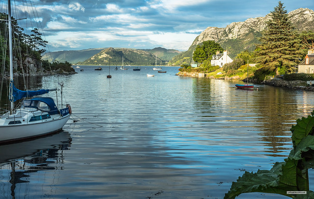 A Plockton Bay at sunset in summer, a peaceful, calm mooring for the boating fraternity, Wester Ross, Scotland.