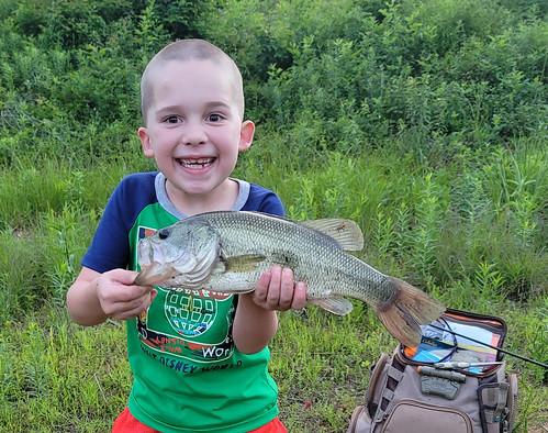 Photo of boy holding a largemouth bass