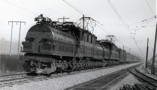 Milwaukee Road bipolars E1 & E3 pull a passenger train through Auburn, WA