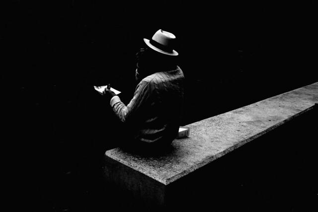 Urban picnic of a lonely elegant man
