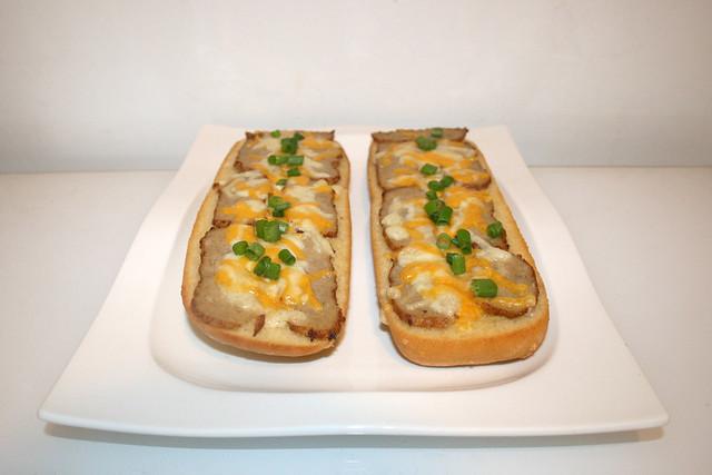 Cheese meatball garlic baguette  Side view / Knoblauch-Baguette mit Frikadelle & Käse - Seitenansicht