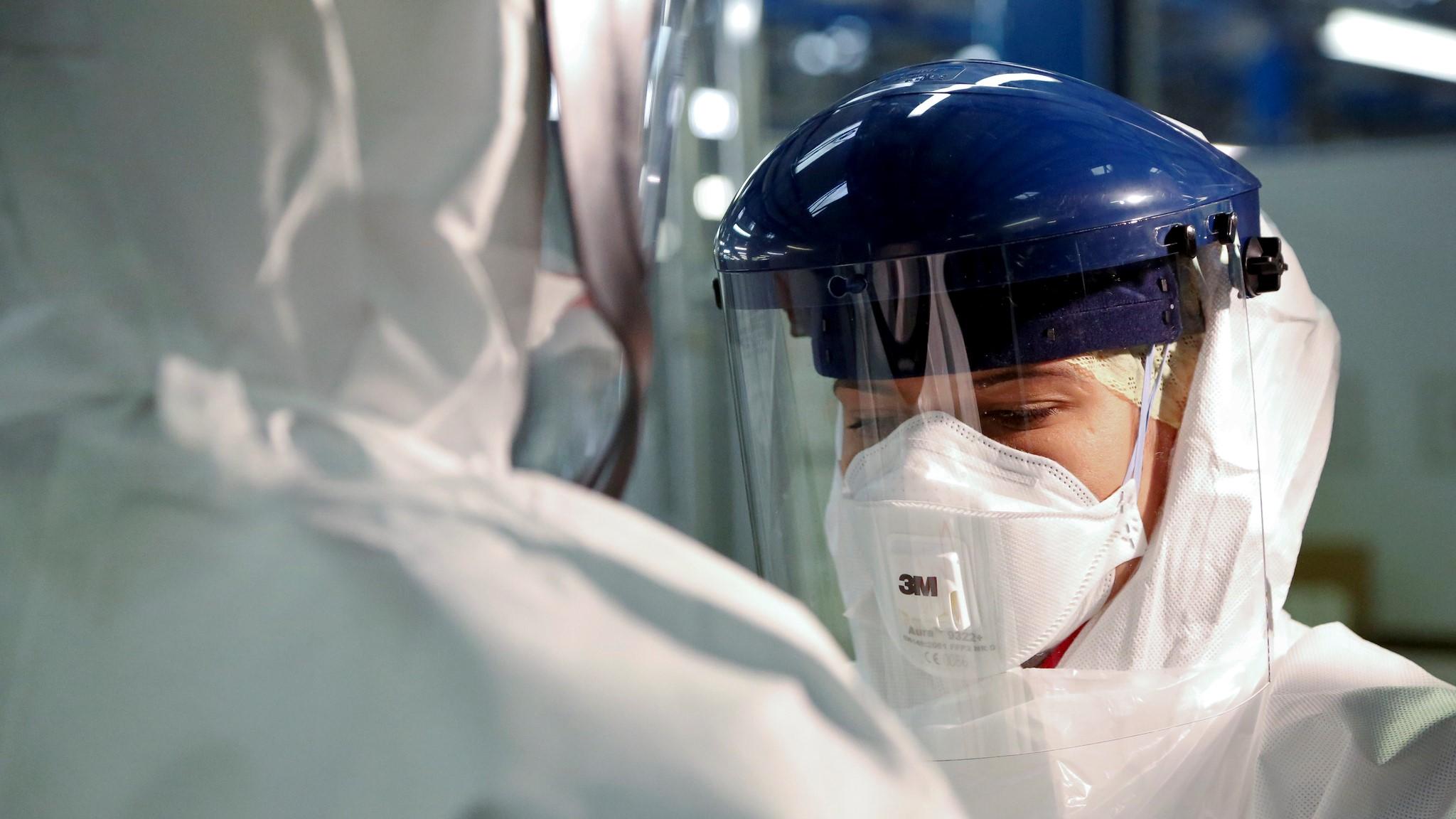 A woman wearing PPE