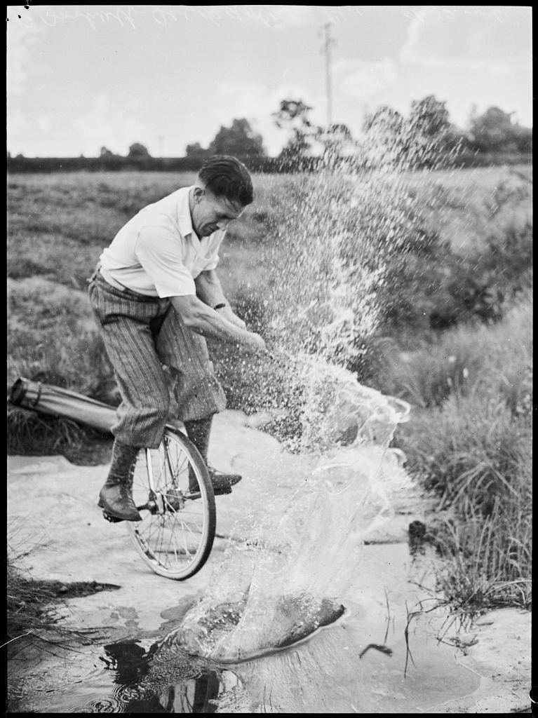 Trick cyclist and golfer Banner Forbutt, December 1946
