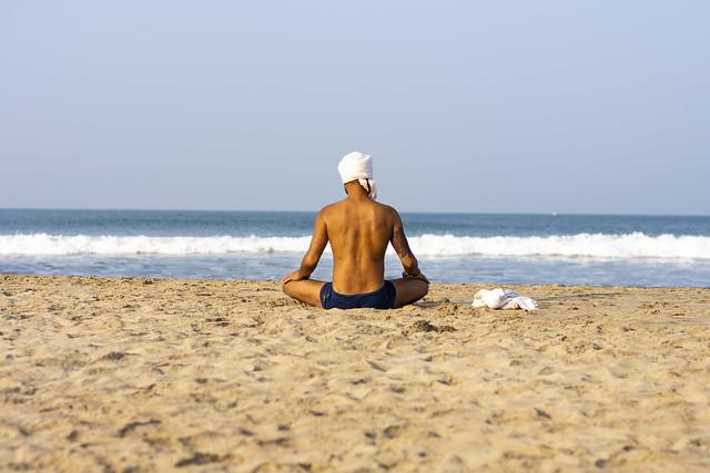 Man meditating at the beach