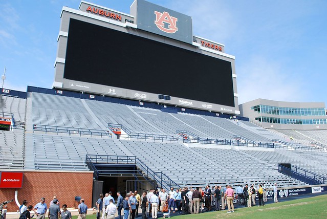 A group of international military officers tours Jordan-Hare Stadium.