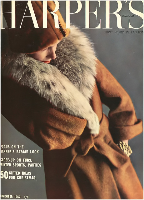 Jennifer Hocking in coat of cinnamon-colored bouclé tweed with lynx collar that narrows down to the belt from Hardy Amies Boutique, melusine cloche trimmed in black by Christian Dior Chapeaux, cover by Richard Dormer, Harper's Bazaar UK, Nov. 1962