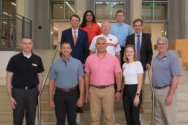 Auburn leaders and Maxwell Air Force Base officers pose at the Auburn library.