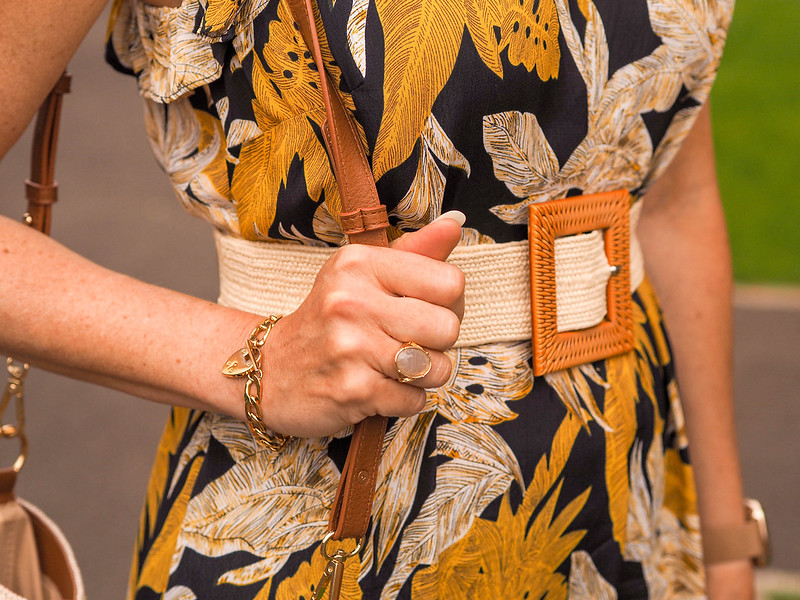 The Power of Accessories: Styling a Tiered Summer Dress (yellow/black/white dress with raffia belt, white slider sandals, brown/ecru shoulder bag, yellow lens glasses & a straw trilby) | Not Dressed As Lamb