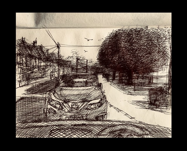 Waiting for my Grandson outside his School, for Cricket Club to finish. Quick sketch of street scene in Ballpoint pen through my car windscreen. No2 New sketch book 2021. On recycled card.