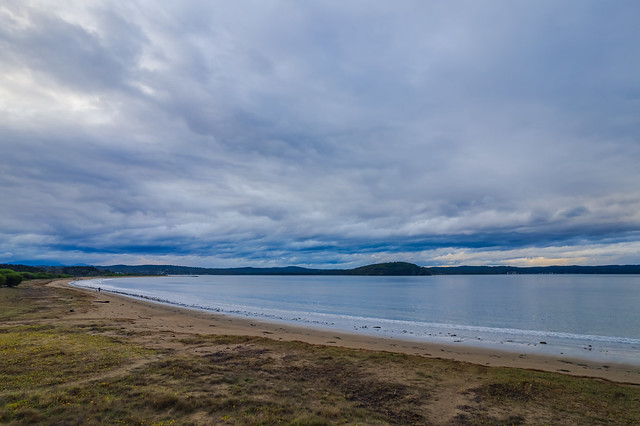 Rain clouds and aerial reverse sunset seascape at Corrigans Beach