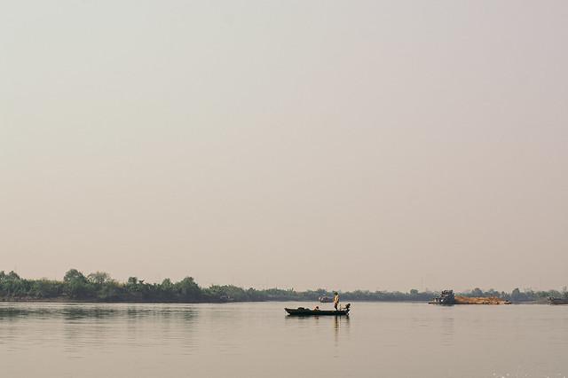 Fisherman on Mekong river, Vietnam
