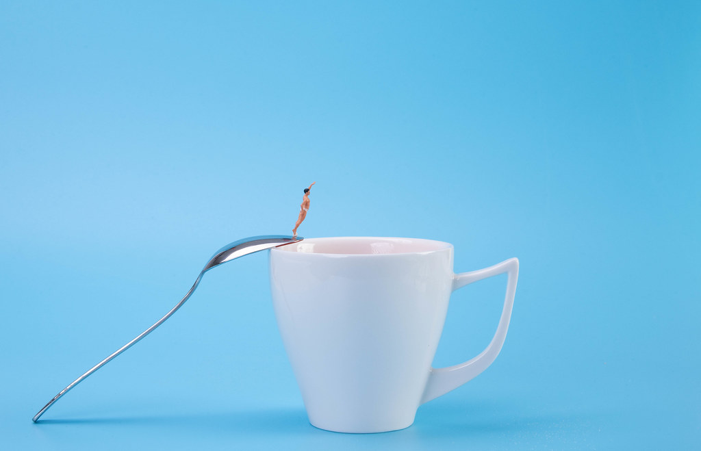 Man jumping into the coffee cup