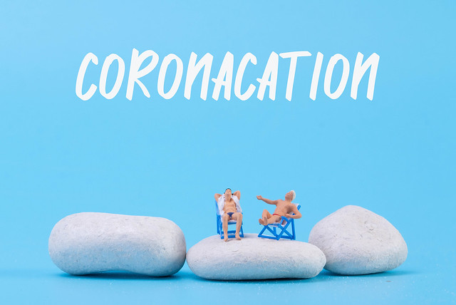 Two man relaxing in deck chairs with Coronacation text