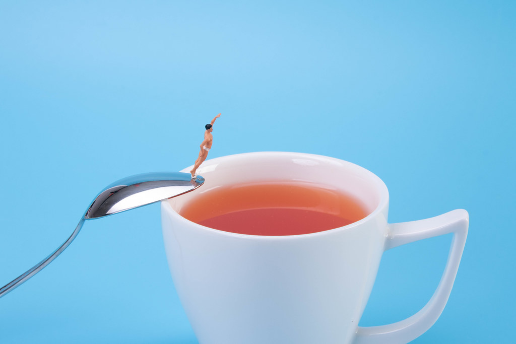 Man jumping into the tea cup