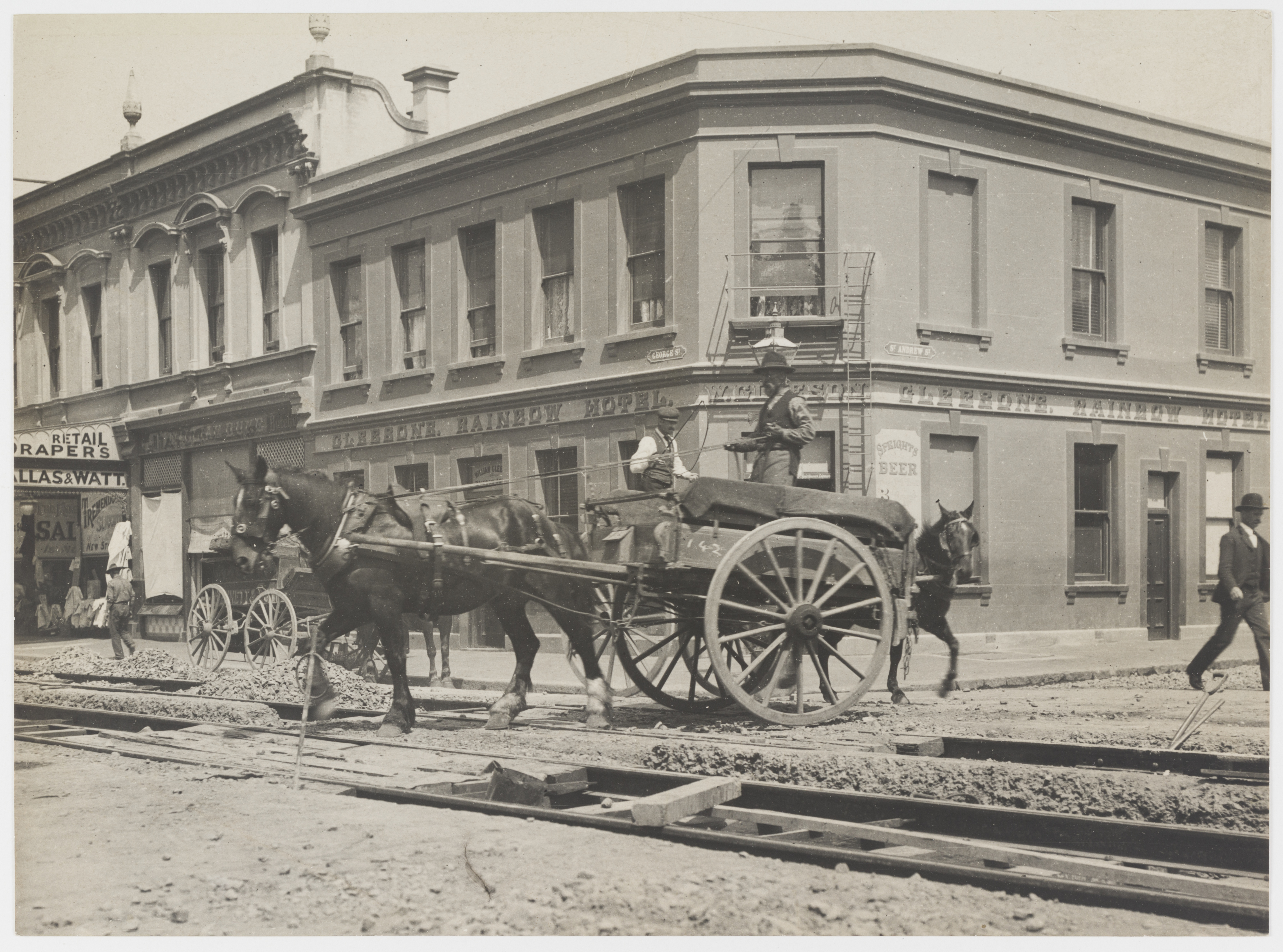 Laying tram tracks, St Andrews and George Streets, Dunedin, New Zealand, c. 1900