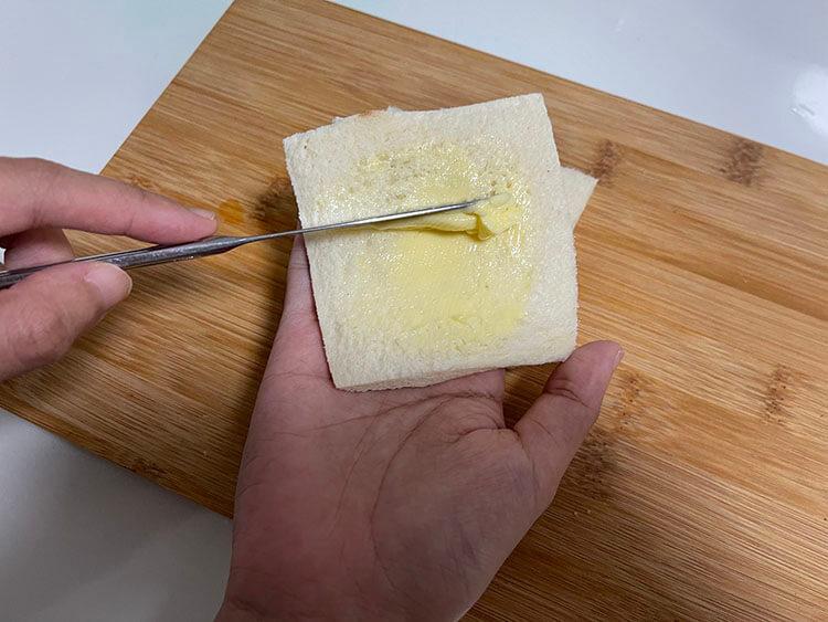 Lightly butter one side of each slice of bread