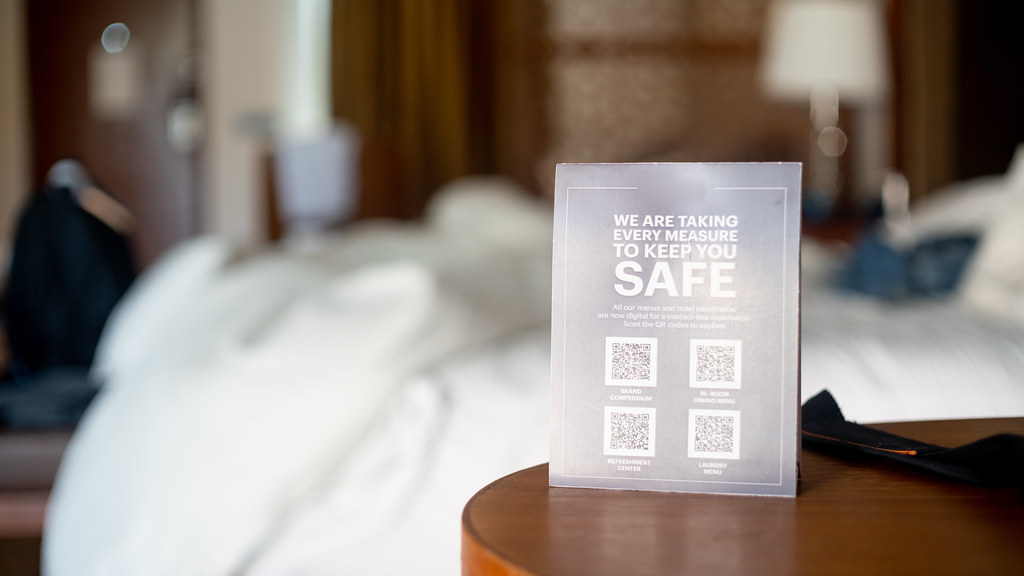 Hotel room with covid signage: Credit Adobe Stock