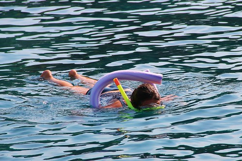 Person snorkeling. From Heading to the Beach? Your Indispensable Packing List