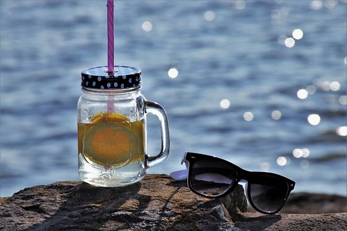 Glass of cold iced tea on the beach. From Heading to the Beach? Your Indispensable Packing List
