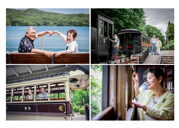 夫婦の記念写真 熟年カップル 電車 湖