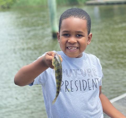 Photo of boy holding a yello perch