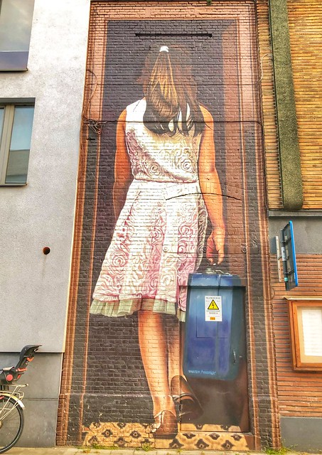 """beautiful mural """"Girl with suitcase"""" from artist Smates"""