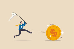 Chasing high performance active mutual fund, buying rising star stock or funds, catch or grab hot ETFs concept, businessman investor run chasing try to catch high performance attractive dollar coin.