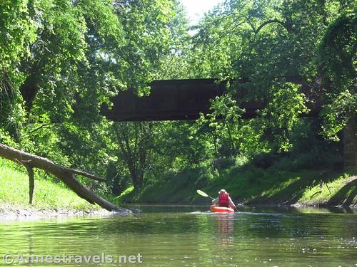 Kayaking back up under the trail bridge over Honeoye Creek, West Rush, New York