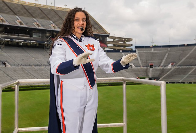 Brianna Jarvis in a conductor's stand at Jordan-Hare Stadium.